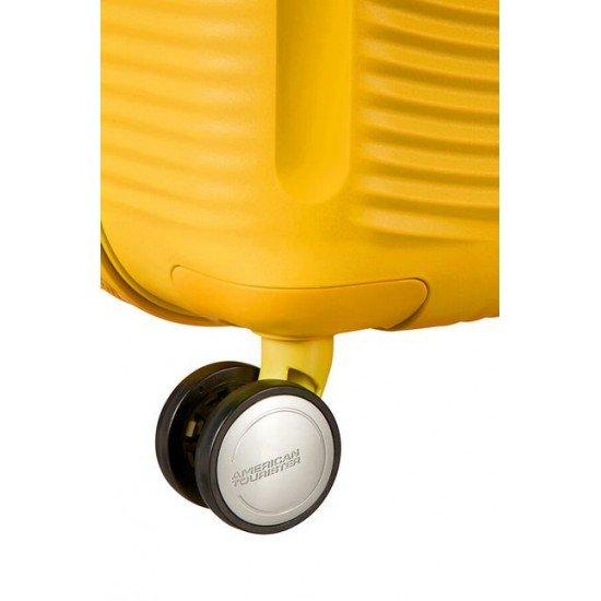 American Tourister куфар Soundbox 67 см - златно жълто